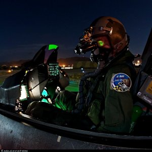 340 SQN pilot prepping for a night sortie